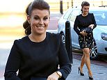Coleen Rooney arrives at the Carolyn Hughes PR Christmas party at the Gusto restaurant in Liverpool. 5 December 2014. Please byline: Peter Goddard/Vantagenews.co.uk