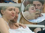 Miley Cyrus and Patrick Schwarzenegger kiss and cuddle at a restaurant on vacation in Miami. \n\nRef: SPL905570  051214  \nPicture by: Splash News\n\nSplash News and Pictures\nLos Angeles: 310-821-2666\nNew York: 212-619-2666\nLondon: 870-934-2666\nphotodesk@splashnews.com\n