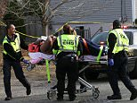 EMTs transport shooting victim rapper Beanie Sigel from a house on Spruce Avenue in Plesantville, Friday Dec. 5, 2014, where he and another man were wounded.