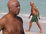 129935, Russell Simmons takes a dip in the ocean on Miami Beach. Russell went shirtless as he drove into the ocean this afternoon for a quick swim. Miami, Florida - Friday December 05, 2014. Photograph: Brett Kaffee/Thibault Monnier, © Pacific Coast News. Los Angeles Office: +1 310.822.0419 London Office: +44 208.090.4079 sales@pacificcoastnews.com FEE MUST BE AGREED PRIOR TO USAGE.
