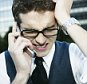 Frustrated Businessman Using Cell Phone.   Image by   Mango Productions/Corbis