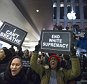Protesters yell in the Apple store on 5th Avenue during a march for Eric Garner in New York December 5, 2014. Protesters in New York and other cities staged a third night of rallies on Friday, denouncing use of deadly force by police against minorities. This week's wave of angry but largely peaceful protests began Wednesday when a New York grand jury declined to bring charges against white police officer Daniel Pantaleo in the chokehold death of Garner, a black 43-year-old father of six. REUTERS/Andrew Kelly (UNITED STATES - Tags: CRIME LAW CIVIL UNREST POLITICS)
