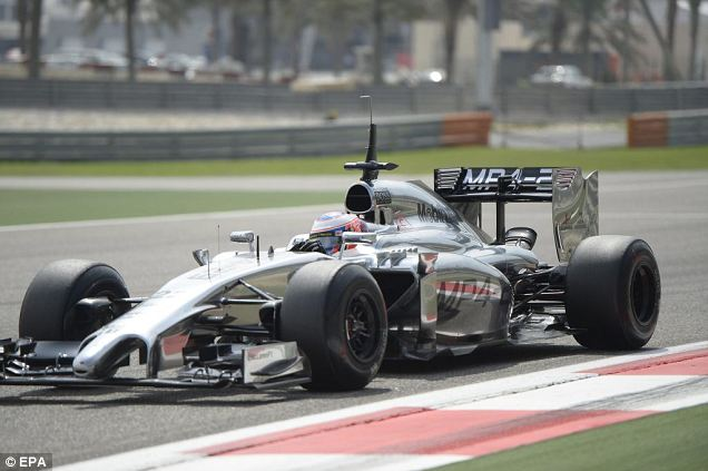 Silver arrow: The British driver's car gleams on the track ahead of the new season's start