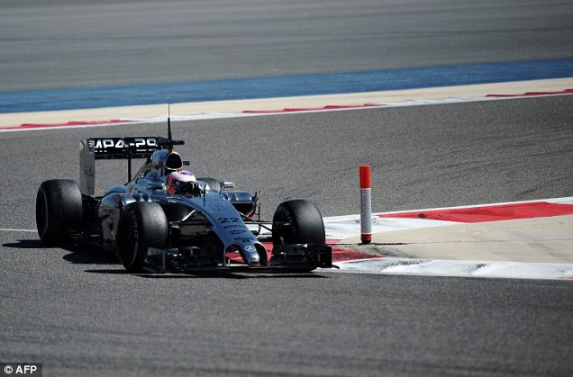 Promising: Button's McLaren has performed reasonably well during pre-season testing in Bahrain's Sakhir circuit ahead of the Bahrain Formula One Grand Prix. Finnish driver Valterri Bottas in a Williams set the fastest time.  AFP PHOTO/MOHAMMED AL-SHAIKHMOHAMMED AL-SHAIKH/AFP/Getty Images