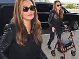 5.DEC.2014 - LOS ANGELES - USA SUPERSTAR BEYONCE'S MOTHER AMERICAN BUSINESSWOMAN AND FASHION DESIGNER KNOWN FOR HER HOUSE OF DER   ON TINA KNOWLES ARRIVES AT LOS ANGELES INTERNATIONAL AIRPORT PUSHING A FOLD UP WHEELCHAIR/WALKER BYLINE MUST READ : XPOSUREPHOTOS.COM *AVAILABLE FOR UK SALE ONLY* ***UK CLIENTS - PICTURES CONTAINING CHILDREN PLEASE PIXELATE FACE PRIOR TO PUBLICATION *** *UK CLIENTS MUST CALL PRIOR TO TV OR ONLINE USAGE PLEASE TELEPHONE 0208 344 2007*
