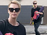 """Picture Shows: Charlize Theron  December 05, 2014\n \n """"Mad Max: Fury Road"""" star Charlize Theron enjoys some time to herself as she goes to a yoga class in West Hollywood, California. Charlize dressed casually in a black sweater and print leggings.\n \n Non-Exclusive\n UK RIGHTS ONLY\n \n Pictures by : FameFlynet UK © 2014\n Tel : +44 (0)20 3551 5049\n Email : info@fameflynet.uk.com"""