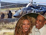 EXCLUSIVE: *PREMIUM EXCLUSIVE RATES APPLY* Beyonce and Jay-Z wrap up against the cold as they are spotted in Iceland after getting out of a helicopter. They pair were there to celebrate Jay-Z's 45th birthday, on December 4. Please note, photo taken on December 3, 2014, the day before his birthday.  Pictured: Beyonce and Jay-Z in Iceland Ref: SPL905366  051214   EXCLUSIVE Picture by: Splash News/SigurjonE  Splash News and Pictures Los Angeles: 310-821-2666 New York: 212-619-2666 London: 870-934-2666 photodesk@splashnews.com