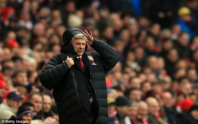 Difficult afternoon: Arsene Wenger was jeered throughout Arsenal's 2-0 defeat but shrugged off the protests