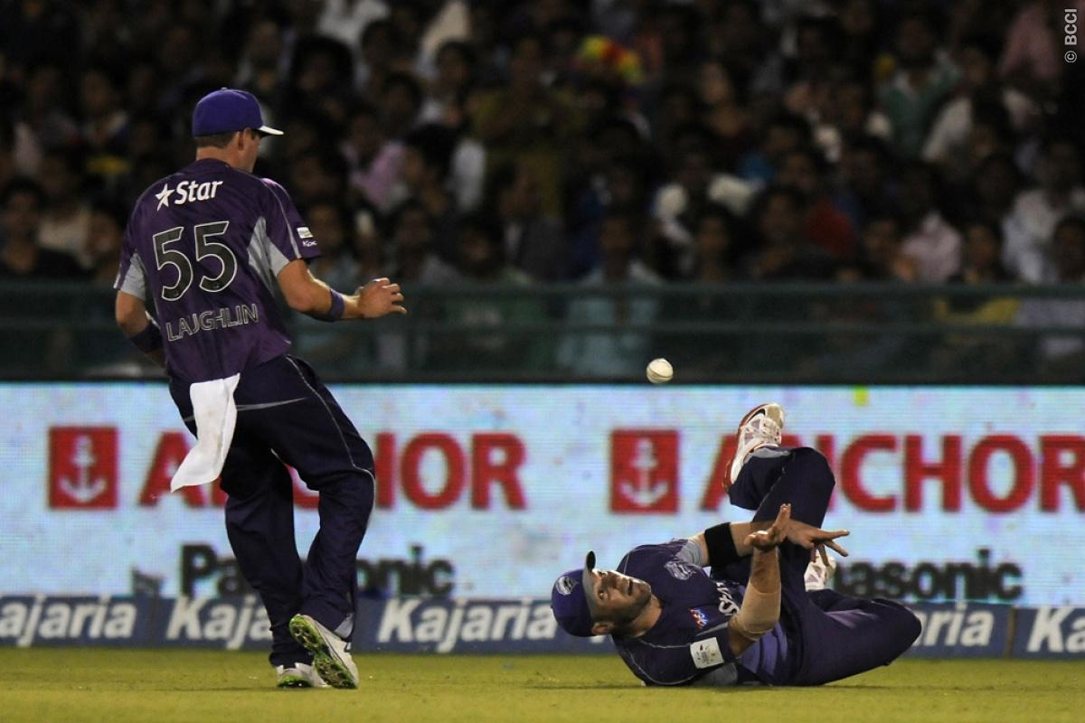 Ben Laughlin of Hobart Hurricanes watches as teammate fields during match 9 of the Oppo Champions League Twenty20 between the Hobart Hurricanes and the Northern knights held at the Chhattisgarh International Cricket Stadium, Raipur, India on the 23rd September 2014  Photo by:  Pal Pillai / Sportzpics/ CLT20   Image use is subject to the terms and conditions as laid out by the BCCI/ CLT20.  The terms and conditions can be downloaded here:  http://sportzpics.photoshelter.com/gallery/CLT20-Image-Te