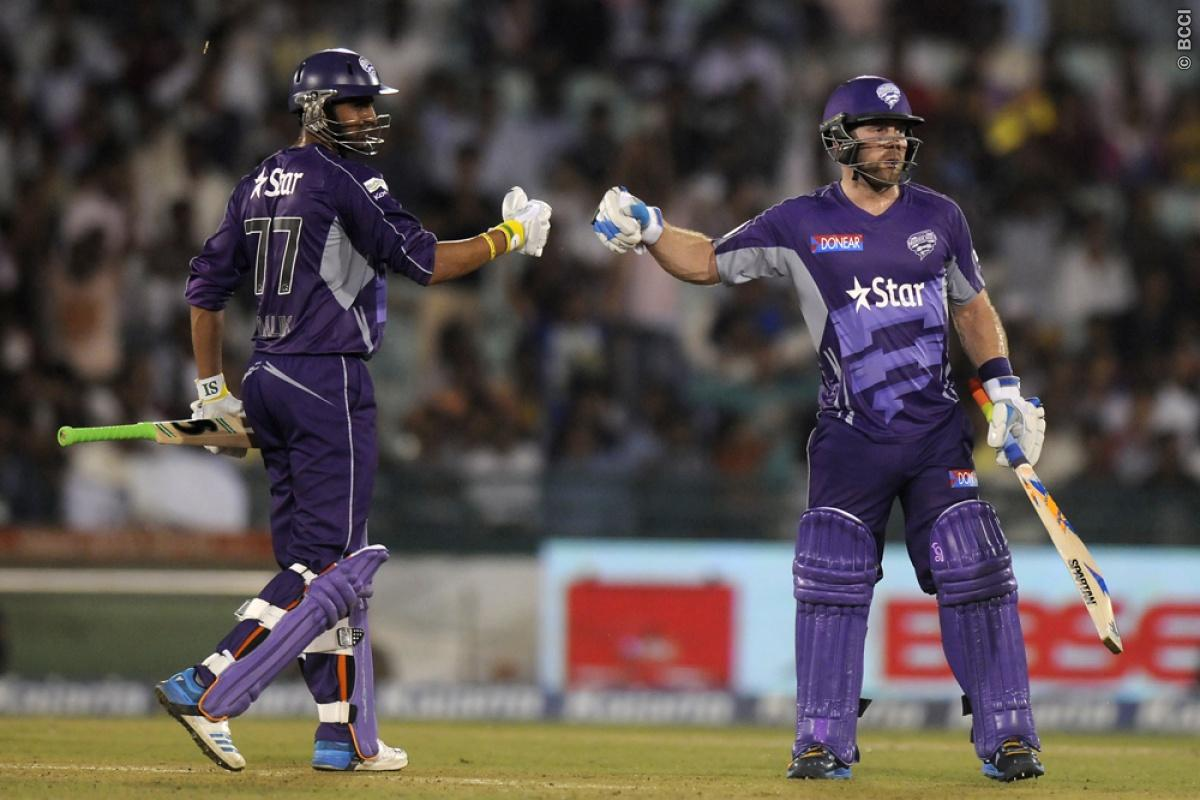 Aiden Blizzard of Hobart Hurricanes and Shoaib Malik of Hobart Hurricanes punch gloves during match 9 of the Oppo Champions League Twenty20 between the Hobart Hurricanes and the Northern knights held at the Chhattisgarh International Cricket Stadium, Raipur, India on the 23rd September 2014  Photo by:  Pal Pillai / Sportzpics/ CLT20   Image use is subject to the terms and conditions as laid out by the BCCI/ CLT20.  The terms and conditions can be downloaded here:  http://sportzpics.photoshelter