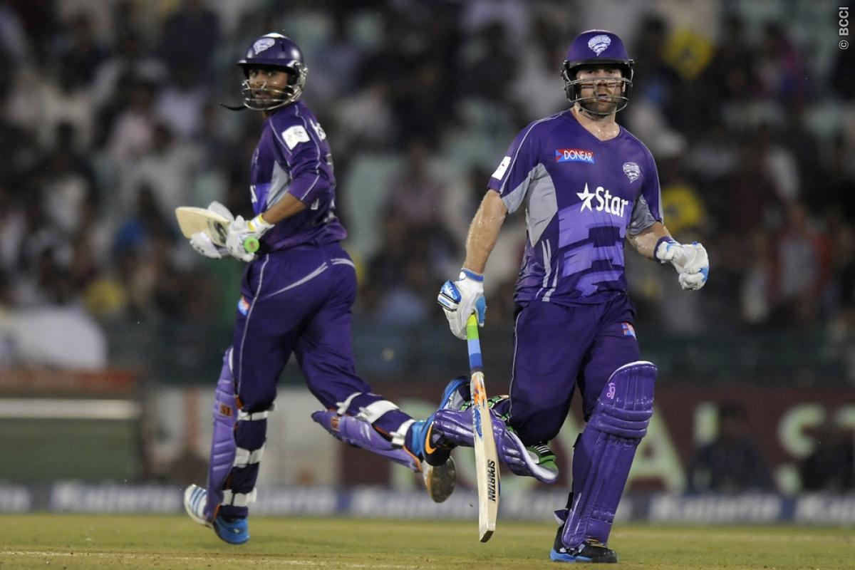 Aiden Blizzard of Hobart Hurricanes and Shoaib Malik of Hobart Hurricanes run between the wickets during match 9 of the Oppo Champions League Twenty20 between the Hobart Hurricanes and the Northern knights held at the Chhattisgarh International Cricket Stadium, Raipur, India on the 23rd September 2014  Photo by:  Pal Pillai / Sportzpics/ CLT20   Image use is subject to the terms and conditions as laid out by the BCCI/ CLT20.  The terms and conditions can be downloaded here:  http://sportzpics.p