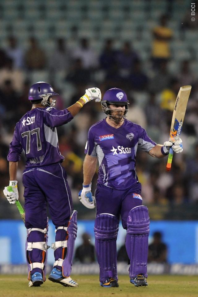Aiden Blizzard of Hobart Hurricanes is congratulated by teammate Shoaib Malik of Hobart Hurricanes as the prior scores a half century during match 9 of the Oppo Champions League Twenty20 between the Hobart Hurricanes and the Northern knights held at the Chhattisgarh International Cricket Stadium, Raipur, India on the 23rd September 2014  Photo by:  Pal Pillai / Sportzpics/ CLT20   Image use is subject to the terms and conditions as laid out by the BCCI/ CLT20.  The terms and conditions can be d