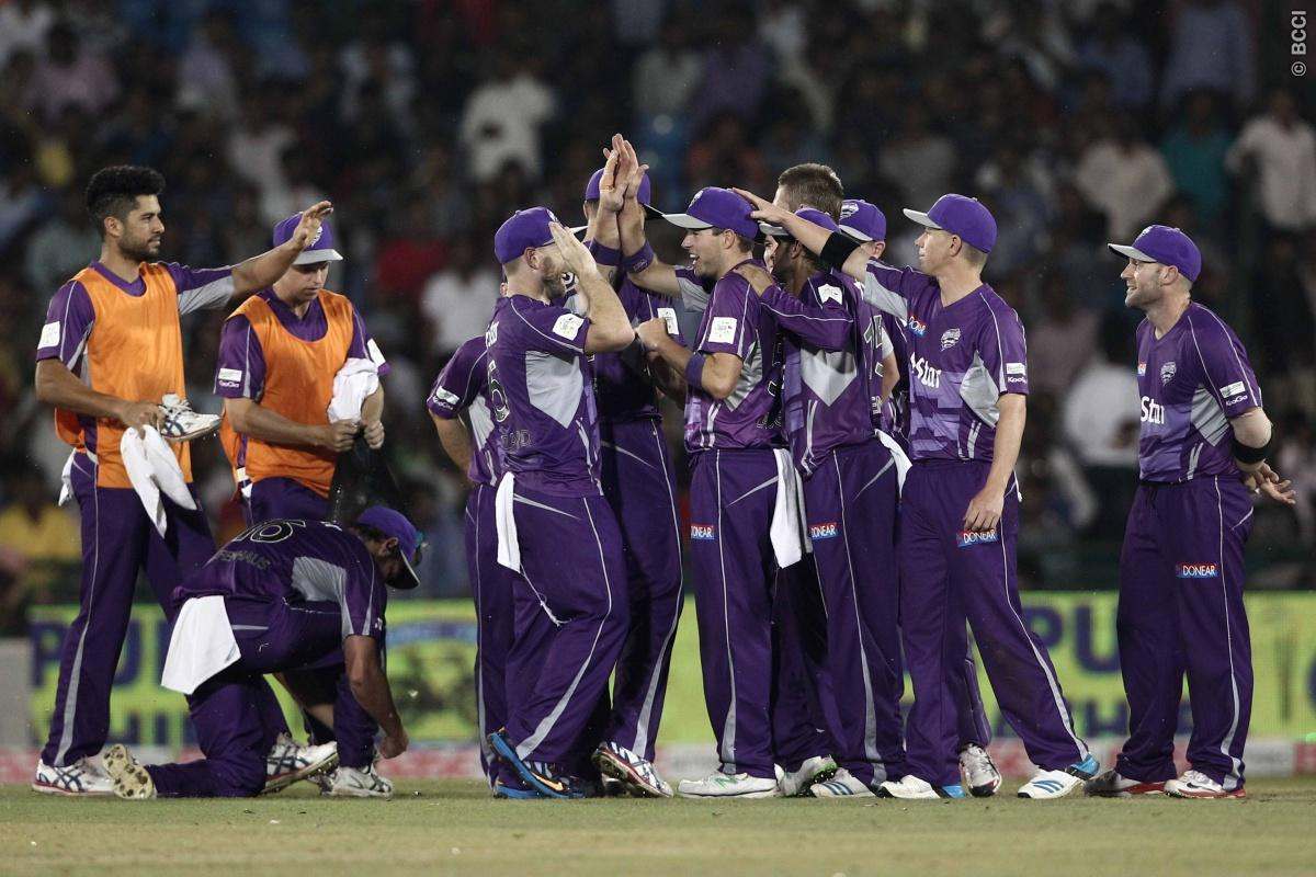 Tim Paine  , Ben Laughlin , Travis Birt of Hobart Hurricanes celebrates the wicket of Anton Devcich of the NORTHERN KNIGHTS during match 9 of the Oppo Champions League Twenty20 between the Hobart Hurricanes and the Northern knights held at the Chhattisgarh International Cricket Stadium, Raipur, India on the 23rd September 2014  Photo by:  Deepak Malik / Sportzpics/ CLT20   Image use is subject to the terms and conditions as laid out by the BCCI/ CLT20.  The terms and conditions can be downloaded