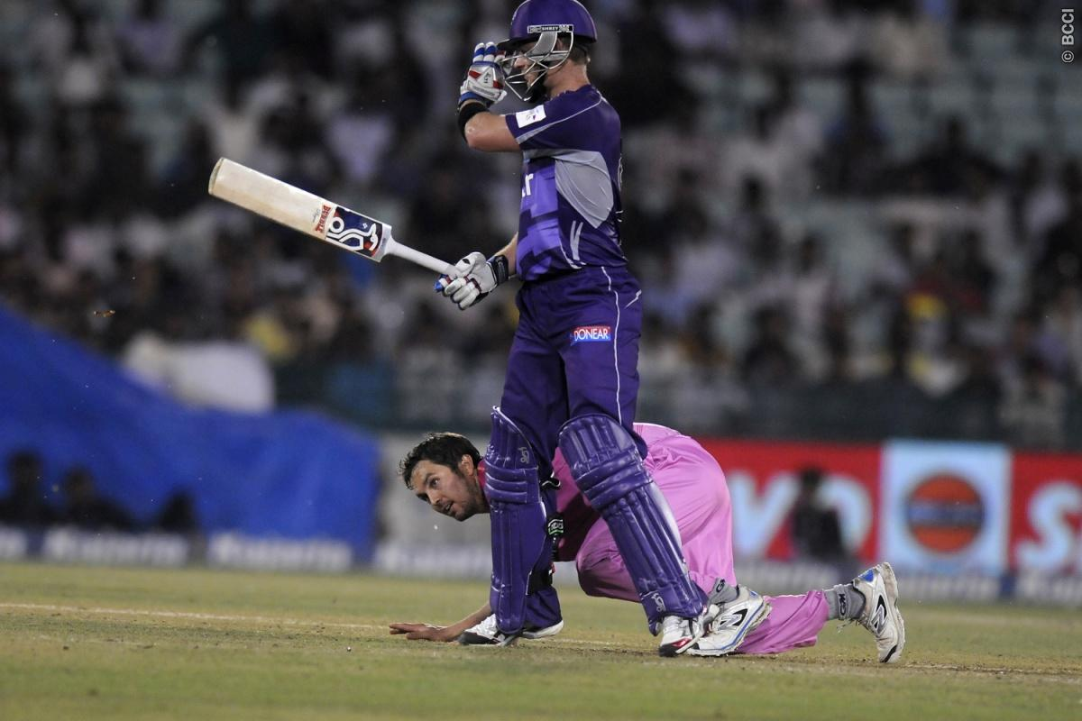 Jono Boult of Northern Knights tries to stop a ball of his own bowling during match 9 of the Oppo Champions League Twenty20 between the Hobart Hurricanes and the Northern knights held at the Chhattisgarh International Cricket Stadium, Raipur, India on the 23rd September 2014  Photo by:  Pal Pillai / Sportzpics/ CLT20   Image use is subject to the terms and conditions as laid out by the BCCI/ CLT20.  The terms and conditions can be downloaded here:  http://sportzpics.photoshelter.com/gallery/CLT