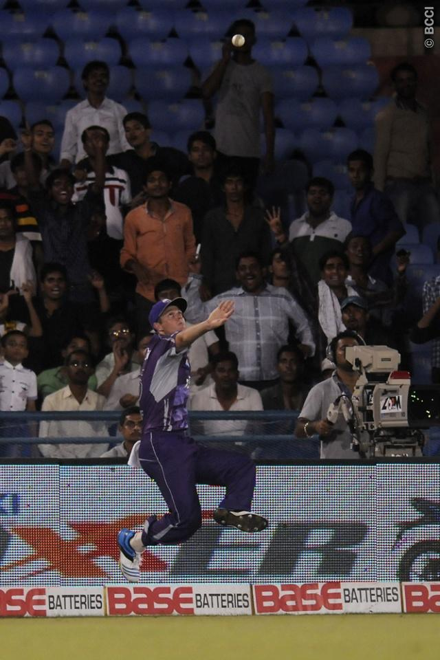 Joe Mennie of Hobart Hurricanes throws the ball ball in to the ground after taking a catch and before over stepping the boundary line during match 9 of the Oppo Champions League Twenty20 between the Hobart Hurricanes and the Northern knights held at the Chhattisgarh International Cricket Stadium, Raipur, India on the 23rd September 2014  Photo by:  Pal Pillai / Sportzpics/ CLT20   Image use is subject to the terms and conditions as laid out by the BCCI/ CLT20.  The terms and conditions can be d