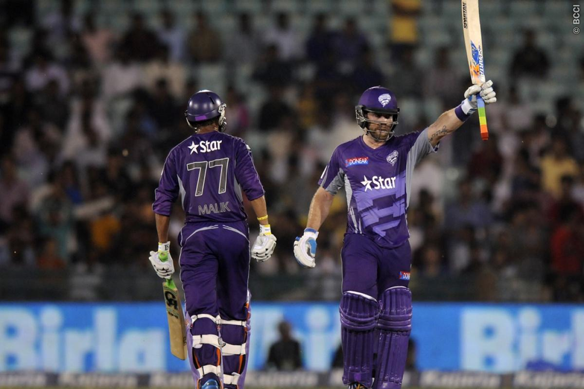 Aiden Blizzard of Hobart Hurricanes raises his bat after scoring a half century during match 9 of the Oppo Champions League Twenty20 between the Hobart Hurricanes and the Northern knights held at the Chhattisgarh International Cricket Stadium, Raipur, India on the 23rd September 2014  Photo by:  Pal Pillai / Sportzpics/ CLT20   Image use is subject to the terms and conditions as laid out by the BCCI/ CLT20.  The terms and conditions can be downloaded here:  http://sportzpics.photoshelter.com/ga