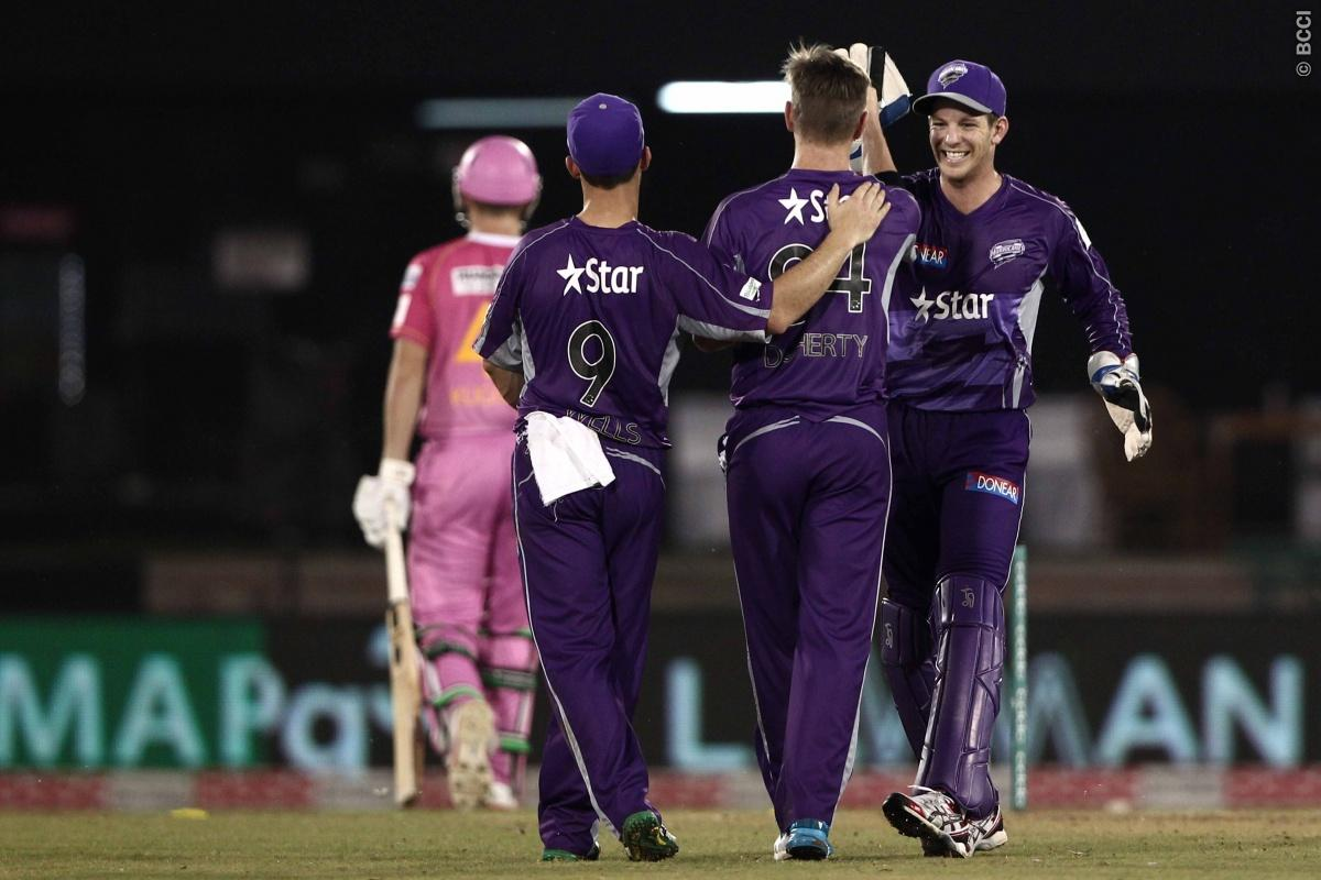 Jonathan Wells , Tim Paine ,  Xavier Doherty of Hobart Hurricanes celebrates the wicket of Scott Kuggeleijn of the NORTHERN KNIGHTS byduring match 9 of the Oppo Champions League Twenty20 between the Hobart Hurricanes and the Northern knights held at the Chhattisgarh International Cricket Stadium, Raipur, India on the 23rd September 2014  Photo by:  Deepak Malik / Sportzpics/ CLT20   Image use is subject to the terms and conditions as laid out by the BCCI/ CLT20.  The terms and conditions can be