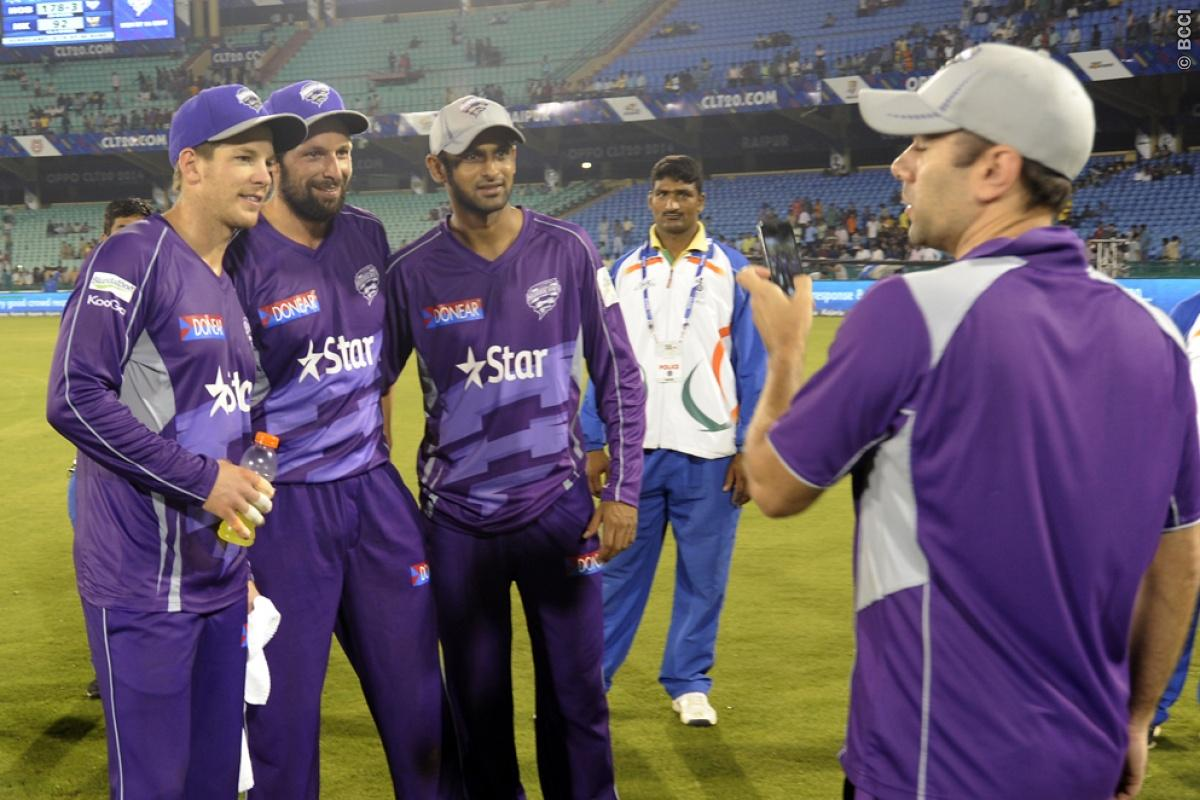 Tim Paine captain of Hobart Hurricanes, Ben Hilfenhaus of Hobart Hurricanes and Shoaib Malik of Hobart Hurricanes pose for a pic as a team member takes their pic during match 9 of the Oppo Champions League Twenty20 between the Hobart Hurricanes and the Northern knights held at the Chhattisgarh International Cricket Stadium, Raipur, India on the 23rd September 2014  Photo by:  Pal Pillai / Sportzpics/ CLT20   Image use is subject to the terms and conditions as laid out by the BCCI/ CLT20.  The te