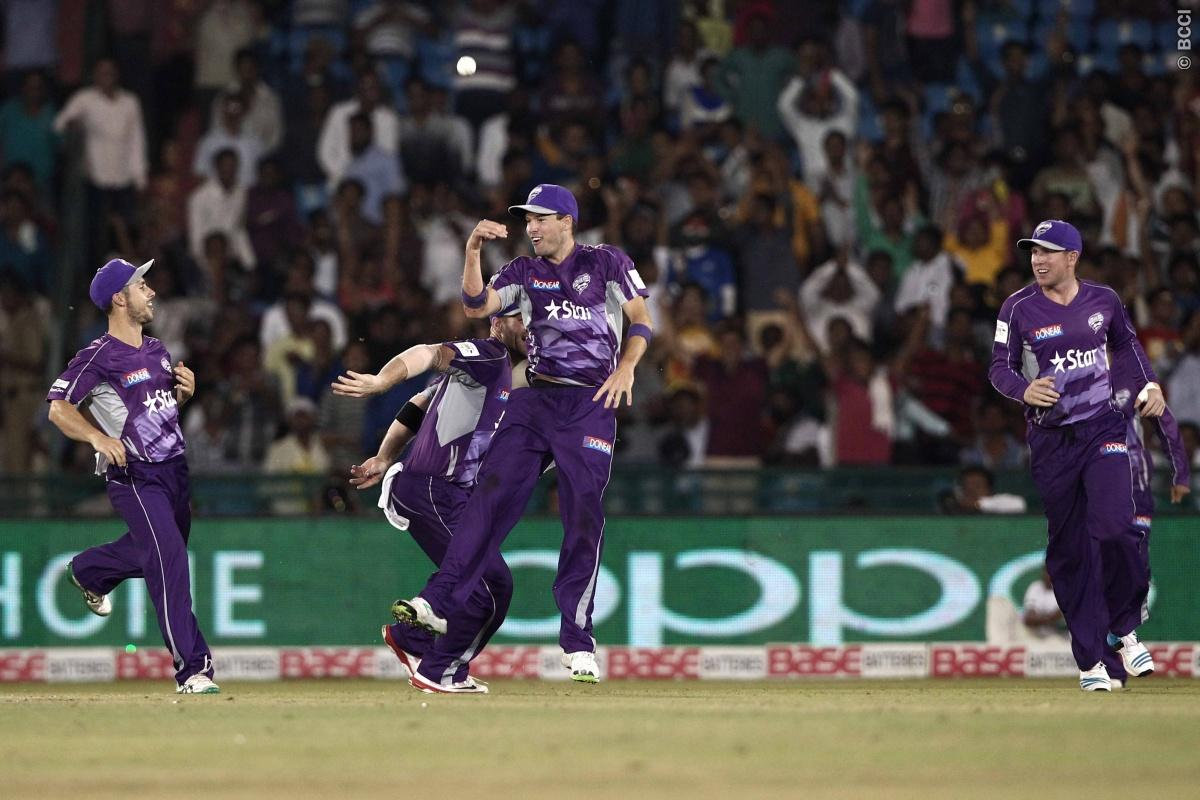 Ben Laughlin , Travis Birt of Hobart Hurricanes celebrates the wicket of Anton Devcich of the NORTHERN KNIGHTS during match 9 of the Oppo Champions League Twenty20 between the Hobart Hurricanes and the Northern knights held at the Chhattisgarh International Cricket Stadium, Raipur, India on the 23rd September 2014  Photo by:  Deepak Malik / Sportzpics/ CLT20   Image use is subject to the terms and conditions as laid out by the BCCI/ CLT20.  The terms and conditions can be downloaded here:  http: