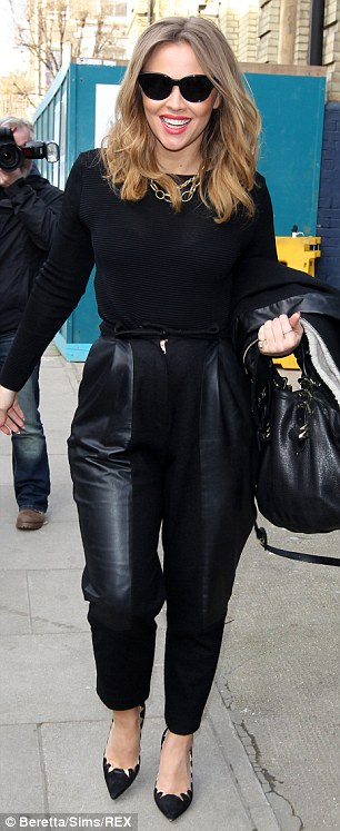 Yummy mummy-to-be: The former Girls Aloud singer opted for a simple, yet elegant, ensemble as she headed out for the day
