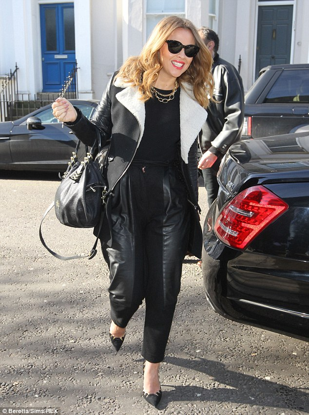 Not ready to ditch the leather: Kimberley Walsh led the long list of stars heading to Sarm Studios in West London to record the official England World Cup song