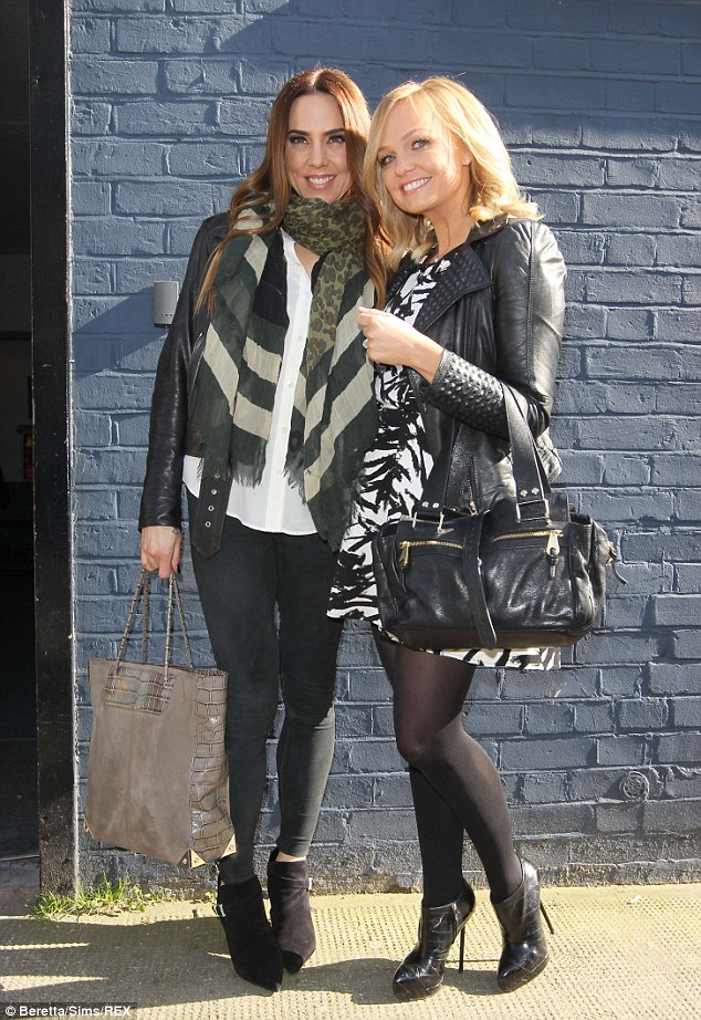 On the ball: Spice Girls singers Mel C and Emma Bunton looked delighted to be heading to the recording session
