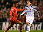 LIVERPOOL, ENGLAND - DECEMBER 09:  Raheem Sterling of Liverpool is closed down by Luca Zuffi of FC Basel during the UEFA Champions League group B match between Liverpool and FC Basel 1893 at Anfield on December 9, 2014 in Liverpool, United Kingdom.  (Photo by Laurence Griffiths/Getty Images)
