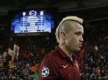 Roma's Radja Nainggolan leaves the pitch at the end of a Group E Champions League soccer match between Roma and Manchester City at the Olympic stadium in Rome, Italy, Wednesday Dec.10, 2014. (AP Photo/Gregorio Borgia)
