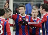 Bayern's Thomas Mueller, third left, celebrates with his teammates after scoring his side's first goal during the Champions League group E soccer match between FC Bayern Munich and CSKA Moscow in Munich, Germany, Wednesday, Dec. 10, 2014. (AP Photo/Matthias Schrader)