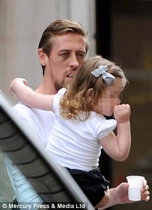 Eyesore: Peter Crouch leaves Liverpool Dental Spa with daughter, Sophia