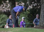 Tiger Woods gathers himself during the third round of the Hero World Challenge golf tournament on Saturday, Dec. 6, 2014, in Windermere, Fla. Woods was apparently nauseous before and during the round.  (AP Photo/Willie J. Allen Jr.)