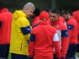 ST ALBANS, ENGLAND - DECEMBER 12: Arsenal manager Arsene Wenger talks with Santi Cazorla and Alex Oxlade-Chamberlain during a training session at London Colney on December 12, 2014 in St Albans, England. Photo by Stuart MacFarlane/Arsenal FC via Getty Images)
