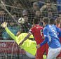 Queen of the South's Kevin Holt scores his side's first goal during the SPFL Championship match at Palmerston Park, Dumfries. PRESS ASSOCIATION Photo. Picture date: Friday December 12, 2014. See PA story SOCCER Queen. Photo credit should read: Jeff Holmes/PA Wire. EDITORIAL USE ONLY