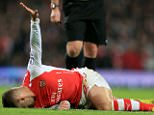 File photo dated 22-11-2014 of Arsenal's Jack Wilshere reacts after suffering an injury during the Barclays Premier League match at the Emirates Stadium, London. PRESS ASSOCIATION Photo. Issue date: Monday December 8, 2014. Jack Wilshere remains on course to return from his latest ankle injury on schedule in around the middle of February, Press Association Sport understands. See PA story SOCCER Arsenal Wilshere. Photo credit should read Mike Egerton/PA Wire.