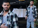 EXCLUSIVE TO INF.\\nDecember 11, 2014: Rapper Drake checks out a luxury sports car while waiting for hotel staff to unload his numerous shopping bags from upscale boutique The Webster in Miami. Drake didn't appear to have a care in the world after making headlines for getting in a fight with fellow rapper Diddy at a nightclub over the weekend.\\nMandatory Credit: INFphoto.com Ref: infusmi-11/13
