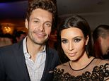LOS ANGELES, CA - FEBRUARY 13:  Ryan Seacrest (L) and Kim Kardashian attend the Topshop Topman LA Opening Party at Cecconi's West Hollywood on February 13, 2013 in Los Angeles, California.  (Photo by Jeff Vespa/Getty Images for Topshop Topman)