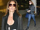 LOS ANGELES, CA - DECEMBER 11: Cindy Crawford is seen at LAX on December 11, 2014 in Los Angeles, California.  (Photo by JOCE/Bauer-Griffin/GC Images)