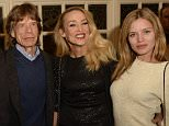 """RICHMOND, ENGLAND - DECEMBER 11:  James Jagger, Mick Jagger, Jerry Hall and Georgia May Jagger attend the press night performance of """"Snow White And The Seven Dwarfs"""" at the Richmond Theatre on December 11, 2014 in Richmond, England.  (Photo by David M. Benett/Getty Images)"""
