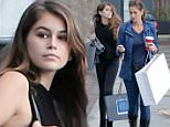 EXCLUSIVE TO INF.\nDecember 12, 2104: A make-up free Cindy Crawford and her look a like daughter Kaya Gerber brave the stormy and wet weather as the glamorous duo go for a morning\nshopping spree at Malibu Beach House, CA.\nMandatory Credit: Borisio/INFphoto.com Ref.: infusla-269