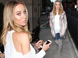 Picture Shows: Lauren Pope  December 14, 2014\n \n 'The Only Way Is Essex' star Lauren Pope wraps up in a fur coat for lunch at Berners Tavern in London, England.\n \n The reality star, who has her own collection with In The Style, kept her look simple in an oversized white blouse with cut-out shoulders and grey thigh high suede boots.\n \n Non Exclusive\n WORLDWIDE RIGHTS\n \n Pictures by : FameFlynet UK © 2014\n Tel : +44 (0)20 3551 5049\n Email : info@fameflynet.uk.com