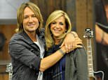 ST PETERSBURG, FL - DECEMBER 14:   Keith Urban debuts his latest PLAYER guitar collection at HSN with Joy Mangano on December 14th in St. Petersburg, Florida. The collection is available via HSN TV, hsn.com and HSN Mobile.  (Photo by Tim Boyles/Getty Images for HSN)