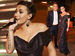 *** MANDATORY BYLINE TO READ: Syco / Thames / Corbis *** Olly Murs and Demi Lovato are seen backstage at the live X Factor final in London.  Credit: Jenkins/Syco/Thames/Corbis  Pictured: Olly Murs, Demi Lovato Ref: SPL912360  141214   Picture by: Jenkins / Syco / Thames / Corbis