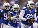 INDIANAPOLIS, IN - DECEMBER  14: Bjoern Werner #92 of the Indianapolis Colts and members of the defense celebrate a fumble recovery against the Houston Texans at Lucas Oil Stadium on December 14, 2014 in Indianapolis, Indiana. (Photo by Michael Hickey/Getty Images)