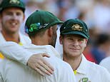 ADELAIDE, AUSTRALIA - DECEMBER 13: Steven Smith (C) hugs teammate Nathan Lyon of Australia after day five of the First Test match between Australia and India at Adelaide Oval on December 13, 2014 in Adelaide, Australia.  (Photo by Morne DeKlerk - CA/Cricket Australia/Getty Images)