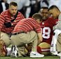 San Francisco 49ers defensive end Lawrence Okoye (98) is tended to after a play in the second half of an NFL preseason football game against the Baltimore Ravens, Thursday, Aug. 7, 2014, in Baltimore. (AP Photo/Gail Burton)
