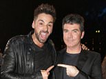 Ben Haenow and Simon Cowell are seen backstage after Ben won the 2014 show. Credit: Dymond/Syco/Thames/Corbis