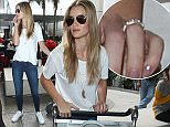 Rosie Huntington-Whiteley is seen pushing her luggage through LAX airport, 14 December 2014. 15 December 2014. Please byline: Vantagenews.co.uk