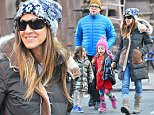 130346, EXCLUSIVE: Sarah Jessica Parker, Matthew Broderick and daughters Marion and Tabitha go out for a family walk in West Village. New York, New York - Sunday December 14, 2014. Photograph: © PacificCoastNews. Los Angeles Office: +1 310.822.0419 sales@pacificcoastnews.com FEE MUST BE AGREED PRIOR TO USAGE