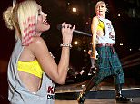 INGLEWOOD, CA - DECEMBER 14:  Singer Gwen Stefani of No Doubt performs onstage during day two of the 25th annual KROQ Almost Acoustic Christmas at The Forum on December 13, 2014 in Inglewood, California.  (Photo by Gabriel Olsen/Getty Images for CBS Radio)