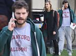 Picture Shows: Jamie Dornan  December 13, 2014\n \n **Min £150 Web/Online Set Usage Fee**\n \n Actors Jamie Dornan and Sarah Gadon spotted on the set of 'The 9th Life Of Louis Drax' in Vancouver, Canada.\n \n The pair were wrapping up filming for the day and getting ready to go home. Jamie could be seen rocking a Stanford University Alumni t-shirt while he talked on his phone.\n \n **Min £150 Web/Online Set Usage Fee**\n \n Exclusive - All Round\n UK RIGHTS ONLY\n \n Pictures by : FameFlynet UK © 2014\n Tel : +44 (0)20 3551 5049\n Email : info@fameflynet.uk.com
